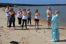 Jakki Lowe teaching a Tai Chi class at the beach