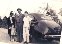 Raburn family 1941 in front of 1940 Chevrolet. HL, HL Jr, Margaret, Judi