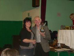 Karen Wadham recieving the Dick Callicott Trophy