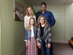 Maddie with her family on her Baptism day