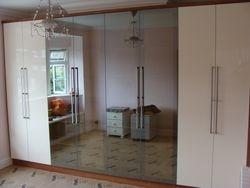 Cream high gloss and mirror door wardrobe
