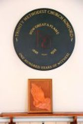 Plaque and praying hands