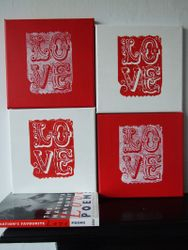 Love canvases shown in red and white