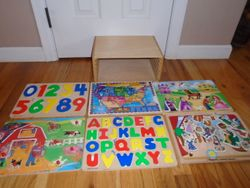 Wood Puzzle Rack with 6 Wood Puzzles - $45