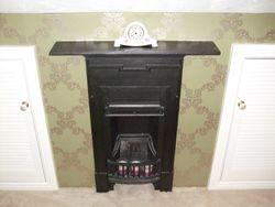 Wallpaper around Victorian Fireplace