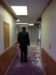 Pastor inspecting renovation