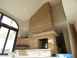 Buff strip stone drystack Fireplace near Boulder Colorado
