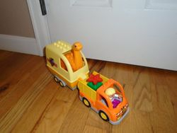 Lego DUPLO Truck & Trailer with Dinosaur - $12