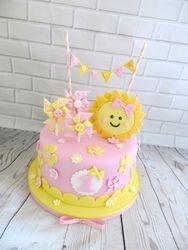 Sunshine and bunting first birthday cake