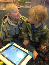 Kian and Henry exploring with an iPad