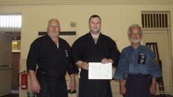 Presentaion of 1st Kyu Iaido to Alan Mitchell by Fujii Sensei and Sensei Brian Ford