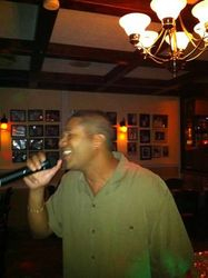 "David bringing some ""Azuquita P'al Cafe"" to the crowd at Joe's Place Friday Night Karaoke Fiesta!"
