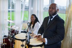 Sandra playing the drums and Godfred playing the konka