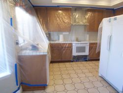drape plastic over cabinet's
