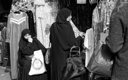 Arab women looking ay dresses, Shepherd's Bush Market