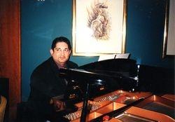 QE2 piano bar 1999 - entertaining fellow passengers