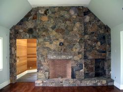 New England fieldstone veneer fireplace