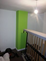 bedroom. in white with lime grean feature wall location stevenage