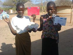 Miss Phiri and Justina (our teachers) receiving monthly wage