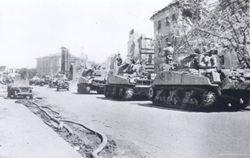 A column of Sherman Tanks: