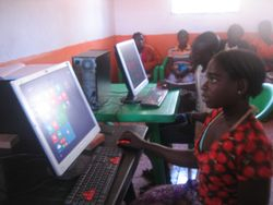 Girls learning computer skills