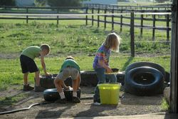 Kids learn about chores along with riding!