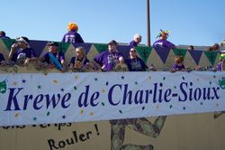 Krewe de Charlie Sioux getting the float ready for the parade