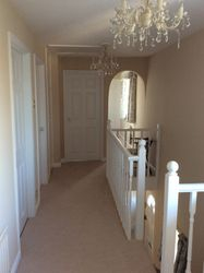 white wood staircase and landing