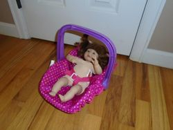 Melissa & Doug Baby Doll with Carrier or Car Seat - $12