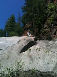 Sitting atop a giant boulder
