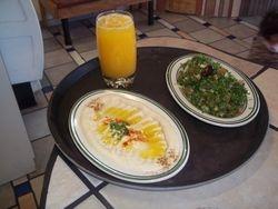 Fresh orange juice Hommus and Tabola