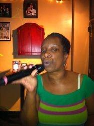 "Khady singing ""Tyrone"" at 502 Bar Lounge's Social Saturday Night Karaoke."