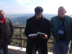 Dr. Timothy Stewart reading Scripture at the top of Mount Carmel