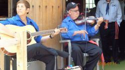 Metis fiddler and guitar player