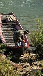 Boat repair in Longneck Karen village