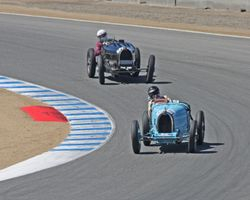 Eventual winner 1932 Bugatti Type 51 presses hard at turn 2