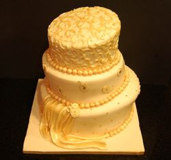 Ivory and Gold Topsy Turvy Wedding Cake