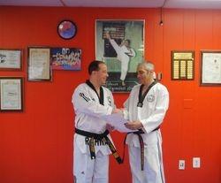 Master Felix Nodarse receiving an award from Grand Master Solomon Pavlou
