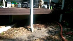 Exposure of basement wall under veranda for waterproofing and retaining wall installation