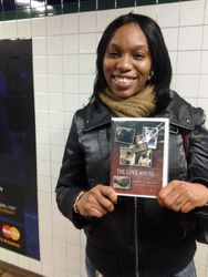 Trefena with a copy of The Love House.