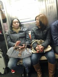 Courtney and our tour guide Trefena riding New York Train