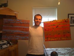 Jeff with Psalm 46:10 and Isaiah 53:5 paintings
