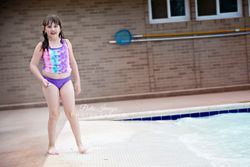 Girl standing at pool party