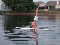 Headstand - stand up paddleboarding