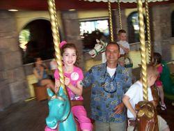 On the carousel outside the Castle of Dreams