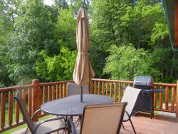 Deck with gas grill, table, 4 chairs