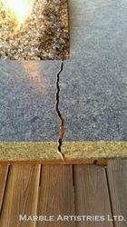 Break in outdoor granite firplace