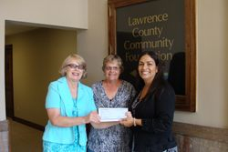 Hope Flores presents a check to LCCPS in 2014