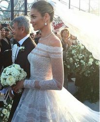 The bride escorted by her father , of the most emotional shots of the day