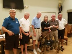 Feb  Meeting Donation to Freedom the Dog
